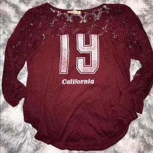 Hollister California top with patterned sleeves
